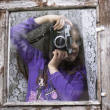 Cheerful kid holding old camera retro Royalty Free Stock Photography