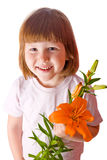 Cheerful kid holding orange lily Royalty Free Stock Photography