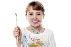 Cheerful kid holding a paint brush Stock Photography