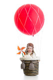 Cheerful kid on hot air balloon Stock Image