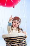 Cheerful kid on hot air balloon in the sky Stock Photo