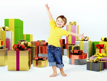 Cheerful kid with lots of presents Royalty Free Stock Images