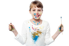 Cheerful kid with paint and brush Royalty Free Stock Photo