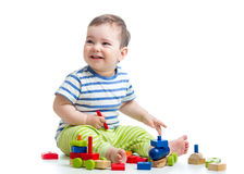 Cheerful kid playing construction set Stock Image