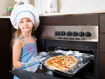 Cheerful kid prepared Italian pizza Royalty Free Stock Image