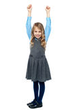 Cheerful kid raising her hands in excitement Stock Photography