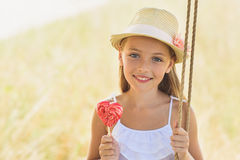 Cheerful kid riding on swing in nature Royalty Free Stock Image