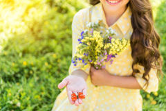 Cheerful kid showing beautiful butterfly Stock Image