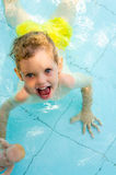Cheerful kid in the swimming pool water Royalty Free Stock Image