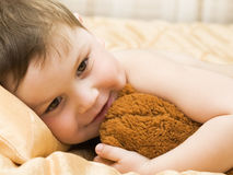 Cheerful kid with teddy bear Stock Image