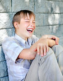 Cheerful Kid by the Wall Royalty Free Stock Photos