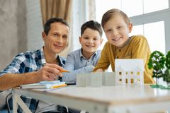 Cheerful kids creating ecology project together with their father Royalty Free Stock Photos