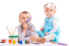 Cheerful kids are drawing. isolated Stock Photos