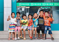 Cheerful kids in front of a pharmacy shop, Ruili, China Royalty Free Stock Photography