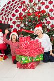 Cheerful kids with many Christmas gifts Stock Images