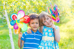 Cheerful kids with pinwheels Royalty Free Stock Photography