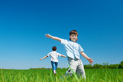 Cheerful kids running Stock Images