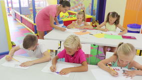 Cheerful kids sitting at school class stock footage
