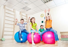 Cheerful kids with their hands up stock photography