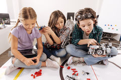 Cheerful kids using gadgets and devices in the studio Stock Photography