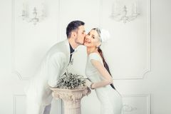 Cheerful kissing bride and groom royalty free stock photo