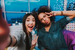 Cheerful ladies having happy time while taking selfie stock photo