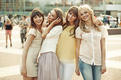 Cheerful ladies in the middle of the square Stock Photo