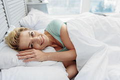 Cheerful lady awaking in her bedroom Royalty Free Stock Photo
