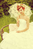 Cheerful lady. Beautiful smiling bride with chaming red hair. Wedding dress and accessories. Wedding decoration Royalty Free Stock Images