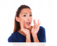 Cheerful lady in blue shirt gesturing screaming Royalty Free Stock Image