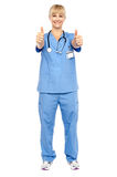 Cheerful lady doctor showing double thumbs up Royalty Free Stock Photo