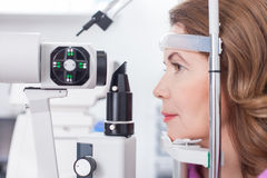 Cheerful lady is getting ophthalmology diopters calibration Royalty Free Stock Photo