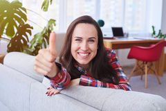 Cheerful lady having rest and putting thumb up Royalty Free Stock Photography