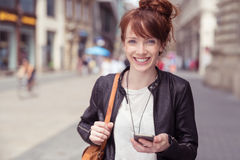 Cheerful Lady Holding Phone, Walking at the Street Stock Image