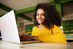 Cheerful lady sitting in a cafe with laptop Royalty Free Stock Image