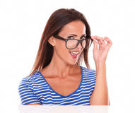 Cheerful lady smiling and wearing spectacles Stock Photo