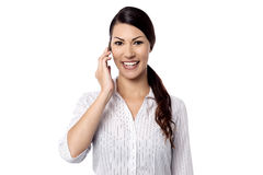Cheerful lady talking on cell phone Stock Image
