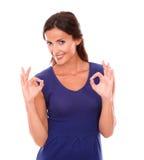 Cheerful latin woman gesturing a great job Stock Image
