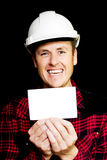 Cheerful laughing builder advertising blank card Stock Photo