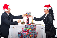 Cheerful laughing couple at Christmas table royalty free stock photo