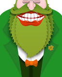 Cheerful leprechaun with green beard. Good gnome with big smile. Stock Photo