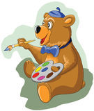 Cheerful little bear holding a brush and paints Royalty Free Stock Photos