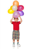 Cheerful little boy with balloons Royalty Free Stock Photos