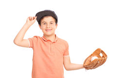 Cheerful little boy with blue cap holding a baseball Stock Photos