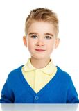 Cheerful little boy in blue cardigan Stock Images