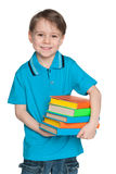 Cheerful little boy with books Royalty Free Stock Photography