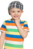 Cheerful little boy in cap looks forward Stock Photo