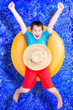 Cheerful little boy celebrating his summer holiday Stock Images