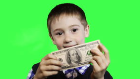 Cheerful little boy close-up, holding dollar stock footage