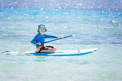 Kid stand up paddleboarding Royalty Free Stock Photography